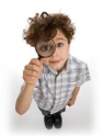 Boy looking thru magnifying glass