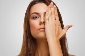 teen with hand over eye
