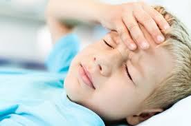 child with head ache
